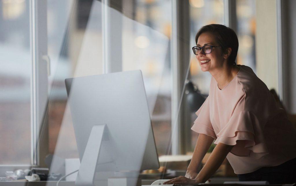woman looking at desktop monitor